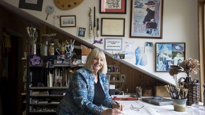 Watercolor artist Ann Vasilik in her studio in North Asheville.