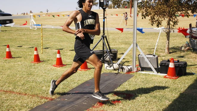 Lubbock High's Isaac Alonzo crosses the finish line to win the Classes 5-6A boys race during the Lubbock ISD Cross Country Invitational on Saturday, October 10, 2020,  at Mae Simmons Park.