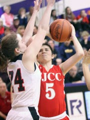 SJCC's Brooke Casperson tries to find space Saturday as Cardinal Stritch's Emily Uher blocks her path.