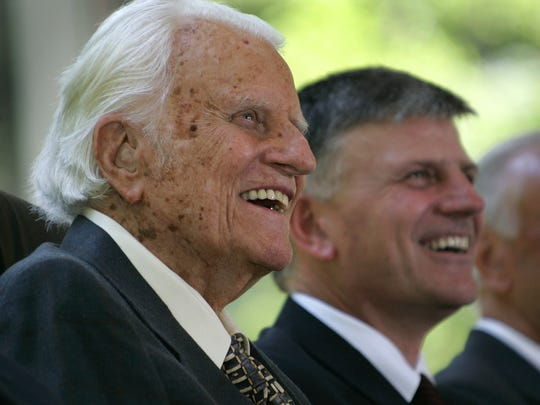 The Rev. Billy Graham, left, and his son, the Rev. Franklin Graham,  smile during a groundbreaking ceremony for the Billy Graham Library in Charlotte, N.C., Friday, Aug. 26, 2005.