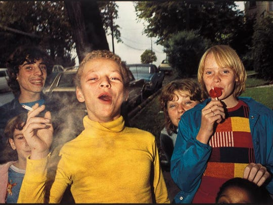 A photo from the 1970s showing kids with lollipops and cigarettes.