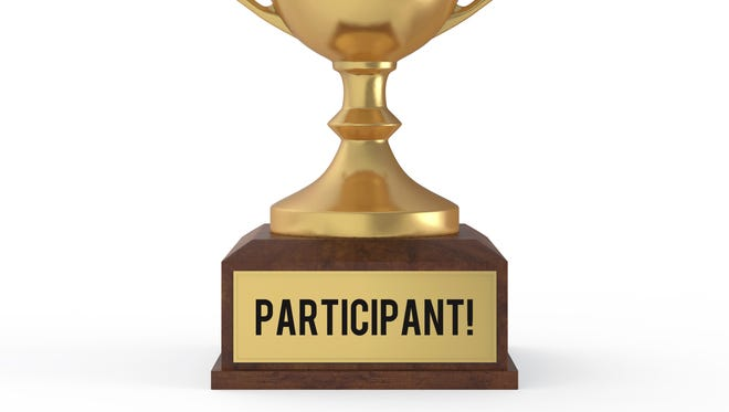 """Seems people nowadays don't want any children to feel badly when their team loses, so now everyone gets a trophy that boldly proclaims, """"Participant."""""""