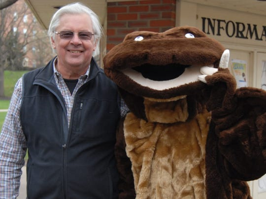 Dr. Peter Petokas with the hellbender mascot, the unofficial mascot of Lycoming College. The mascot is called Allie, a play on the hellbender nickname Allegheny Alligator.