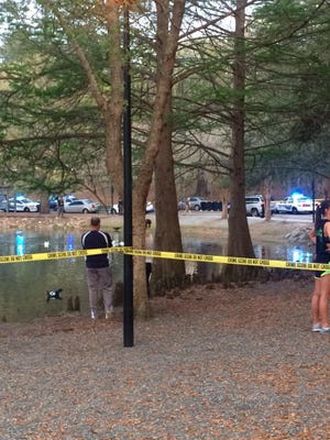A man armed with a gun was shot and killed by police at Lake Ella.