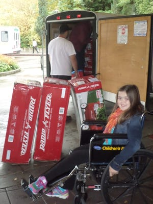 Makenna Schwab organized a toy drive for Make A Difference Day to collect wagons for use by young patients at Seattle Children's Hospital. The kids use the wagons to get around the hospital rather than wheelchairs.