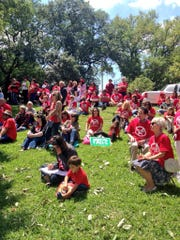 Common Core opponents from across the state gather near the Louisiana State Capitol on Wednesday to protest the educational standards for math and English. Many wear red shirts that feature an anti-Common Core symbol and message.