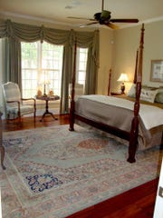 The master bedroom of the home is roomy and elegant.