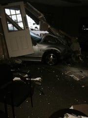 A car crashed into a Salem business Sunday night.
