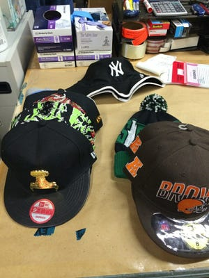 Metro Police seized these counterfeit sports hats Thursday at AA Mart on White Creek Pike.