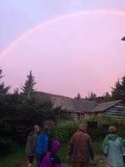 A rainbow arches across the sky at Mount LeConte Lodge in Great Smoky Mountains National Park. The lodge, only accessible by foot, is the highest in the Eastern United States.