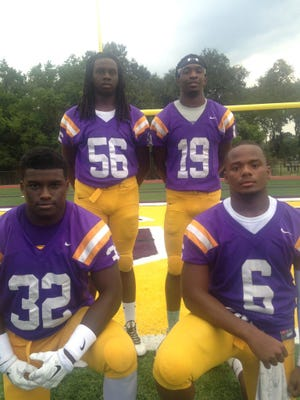 David Charles (32), Stephen Joe (56), Trevious Etienne (19) and Trevon Charles (6) are the stalwarts of the Tigers 4-2-5 defense.