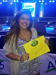 A submitted photo of Chandler Blueberg taken Aug. 29, 2015 at the American Idol tryouts at Whitney Peak Hotel in Reno. Blueberg holds up a golden ticket to the next tryouts held Tuesday in San Francisco.