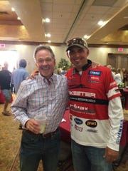 "Rick Seiler of Baird with one of the anglers he ""adopted,"" Marty Robinson, at a meet-and-greet event Wednesday."