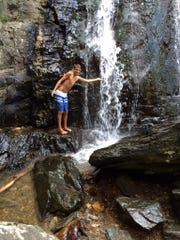 Ben Pessognelli stands next to the falls during a trip he took in August. Submitted photo.