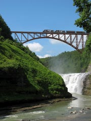 Rendering of the new steel arch railroad bridge under construction in Letchworth State Park.