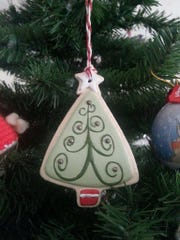 """Michelle Morningstar received this """"cookie cutter"""" ornament from a student in 2003 and hangs it on her tree each year."""
