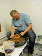 Clint Mecham is hard at work at the pottery wheel.
