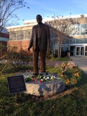 In a spontaneous tribute to Henry Rowan, students began to place flowers at the feet of his statue on the Rowan University campus after learning of his death.