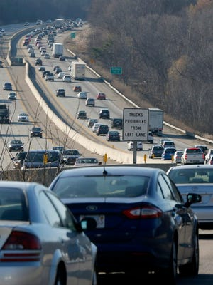 Heavy traffic crawls westbound on the Massachusetts Turnpike (Interstate 90) as people travel for the Thanksgiving holiday near Grafton, Mass., on Nov. 25, 2015. AAA projects winter holiday travelers will top 100 million for the first time, with 90% driving their cars at least 50 miles from home for the holidays.
