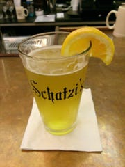 A pint of Ommegang Hennepin is served at Schatzi's.