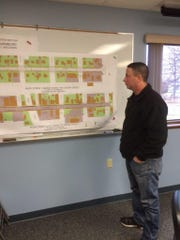 Luxemburg Village President Josh Salentine looks at drawings for the Main Street Enhancement Project.