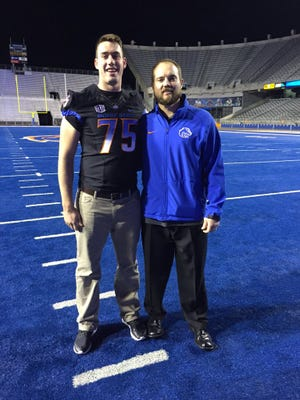 Corona del Sol offensive lineman Austin Dixon poses with Boise State offensive-line coach Scott Huff.