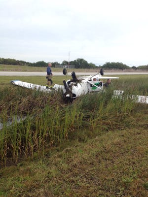 Crews respond to an overturned plane on a runway at Merritt Island Airport