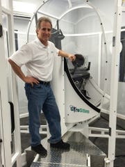 GyroStim creator Kevin Maher, a Delaware native, poses with his device which is used for balance training.
