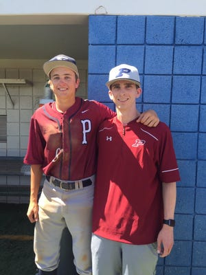 Perry pitcher Tayt Smith (left) poses after his no-hitter with freshman coach Max Kraust, who is the only other Perry player to throw a no-hitter.