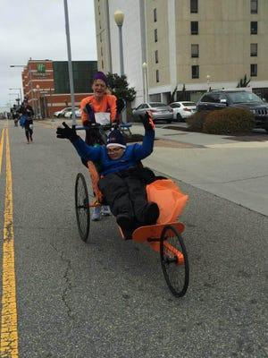 Deb Buenaga and son Preston head to the finish line at the Shamrock Marathon in Virginia Beach on March 20.