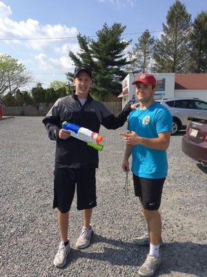 """Cherry Hill East seniors David Golkow (left) """"assassinated"""" Josh Salkin in water gun game"""