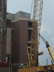 More than 400,000 red bricks were added to the pair of elevator towers outside of Doak Campbell Stadium.