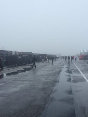 Rain and fog postpone Sunday's Axalta We Paint Winners 400 at Pocono Raceway. The race is schedule to start Monday at noon.