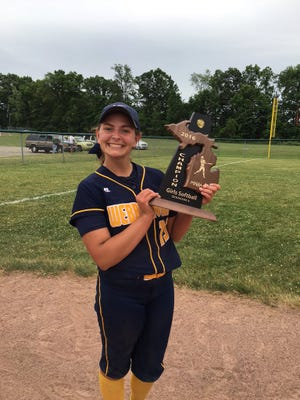Junior pitcher Erin Hunt poses with Webberville's district championship trophy.
