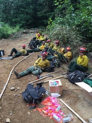 Firefighters from a Maryland crew take a break while battling wildfires in Idaho.