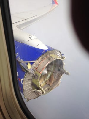 This Saturday, Aug. 27, 2016 photo shows an engine through a window of a Southwest Airlines flight. The flight from New Orleans bound for Orlando, Fla., diverted to Pensacola, Fla., after the pilot detected something had gone wrong with an engine, according to a Southwest statement.