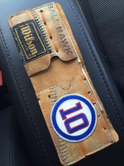This custom-made wallet was circulated on the Chicago Cubs' Twitter feed. The owner, Andrew Hendershott, has ordered 11 products from Jason Hooge in a little more than a year.