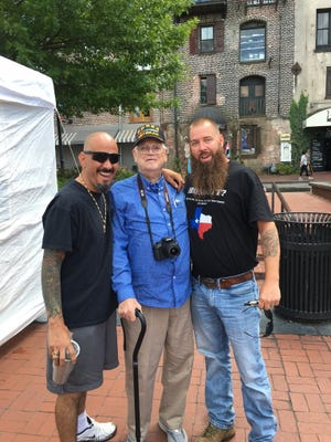 When veterans meet each other what passes across their hands and between their eyes conveys a sense of shared pride that swells the heart but is difficult to describe. Here Al is embraced by a Viet Nam and a Gulf War veteran while traveling in Georgia.