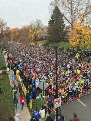 Runners gather at the starting line of the Ashenfelter 8K Classic in Glen Ridge on Thanksgiving morning