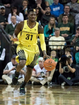 Oregon guard Dylan Ennis (31) dribbles during the first half against Boise State.