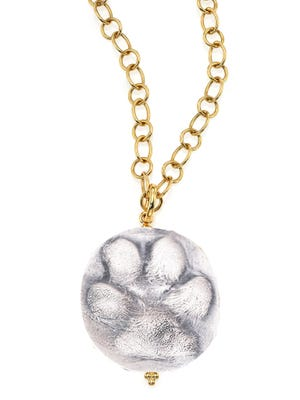 Custom paw print jewelry is available at A. Jaron Studio, Naples.