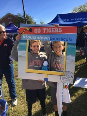 Children participate in a Visit Pensacola activity during the 2015 NCAA FBS season before a game between Auburn and Georgia at Jordan-Hare Stadium.