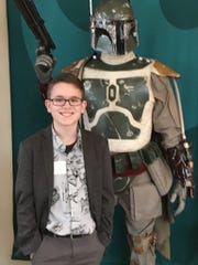 Ian McDonough poses with a Boba Fett model at Lucasfilm headquarters in California.