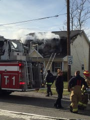 Firefighters battle a house fire on the first block of South Morris Street in Newark.