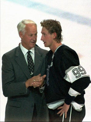 Wayne Gretzky is greeted by Gordie Howe after Gretzky broke Howe's all time scoring record on Oct. 15, 1989.