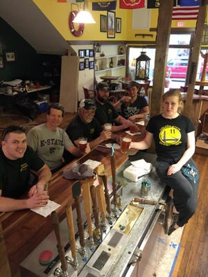 The crew of Shenandoah Valley Brewing Company enjoy a pint at its new location at 103 W. Beverley St. in Staunton