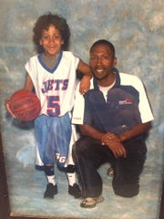 Eli and James Brooks pose for a photo when Eli was in the second grade.