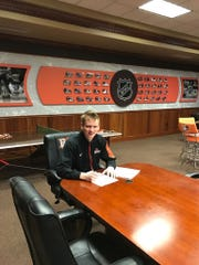 Chris Nell signed an NHL entry-level contract with the New York Rangers on Thursday.