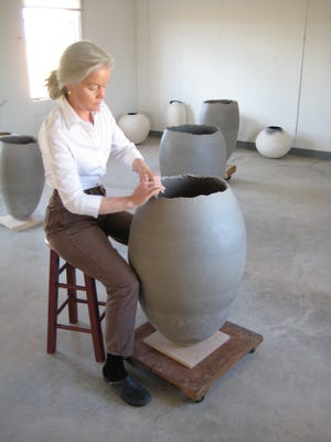 Bonnie Lynch creating her large vessels artwork. Lynch was invited to show her work during the San Angelo Ceramic Invitational Exhibition at San Angelo Museum of Fine Arts