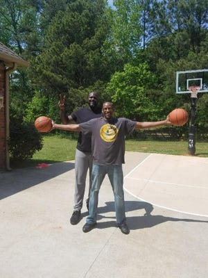 Chris Woodard with Shaq on the basketball court at Shaq's Georgia home. The two met when Woodard was in the Army in Germany and Shaq's father asked him to teach his some how to play basketball. The rest is history.
